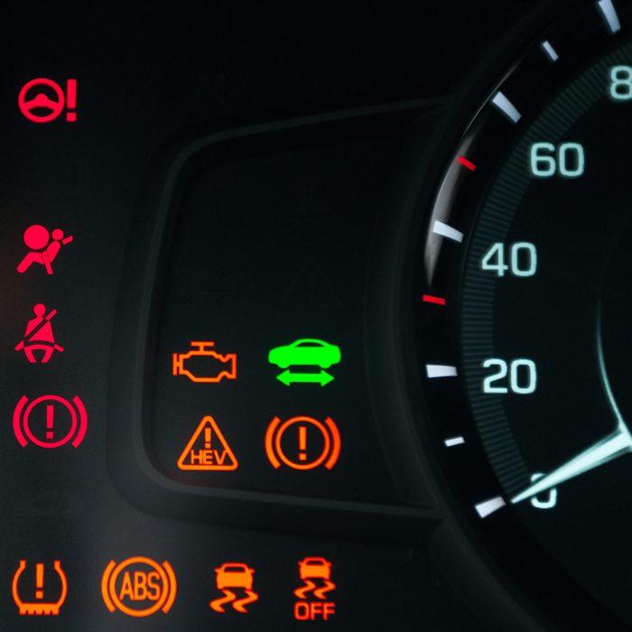 Car dashboard warning lights. Engine start moment. System check. Hybrid car.