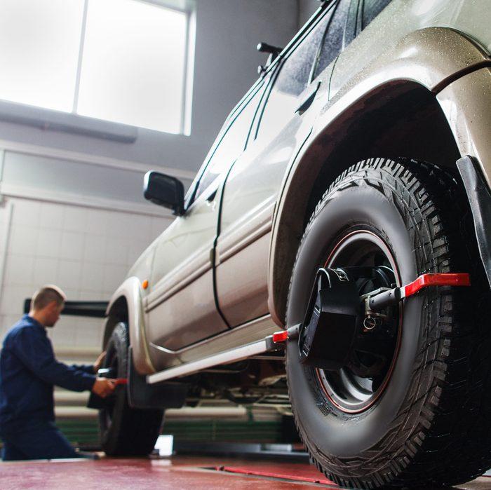 Auto wheel alignment in auto service, SUV maintenance. Car preparing for professional diagnostics