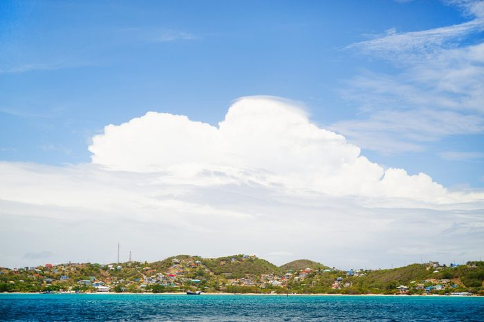 Canouan island shoreline and turquoise Caribbean sea water in St Vincent and the Grenadines