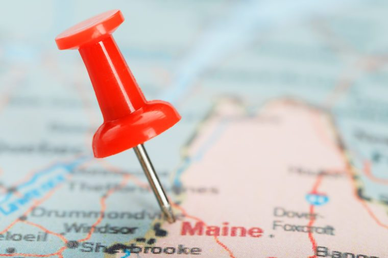 Red clerical needle on a map of USA, South South Maine and the capital Augusta. Close up map of South South Maine with red tack