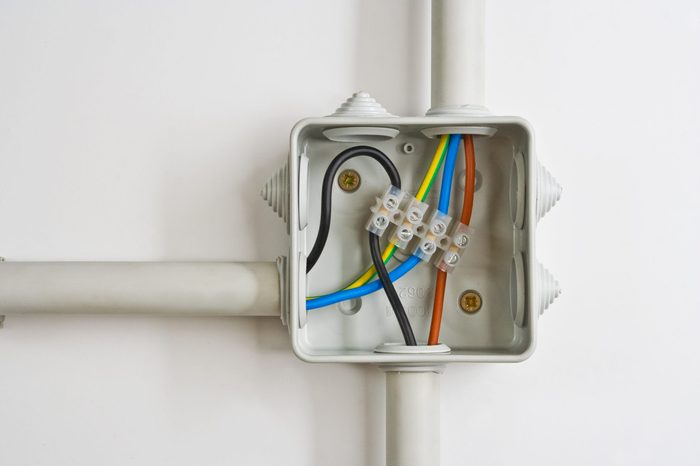 Electrical wire connections in a box.