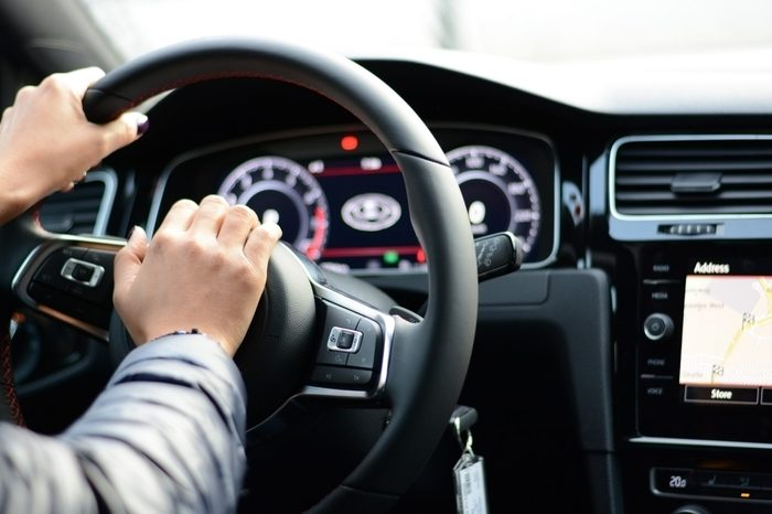 Woman pushing horn while driving