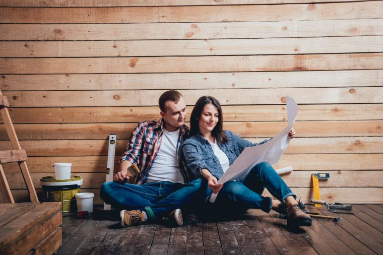 Happy couple making repairs to their home. Home Renovation