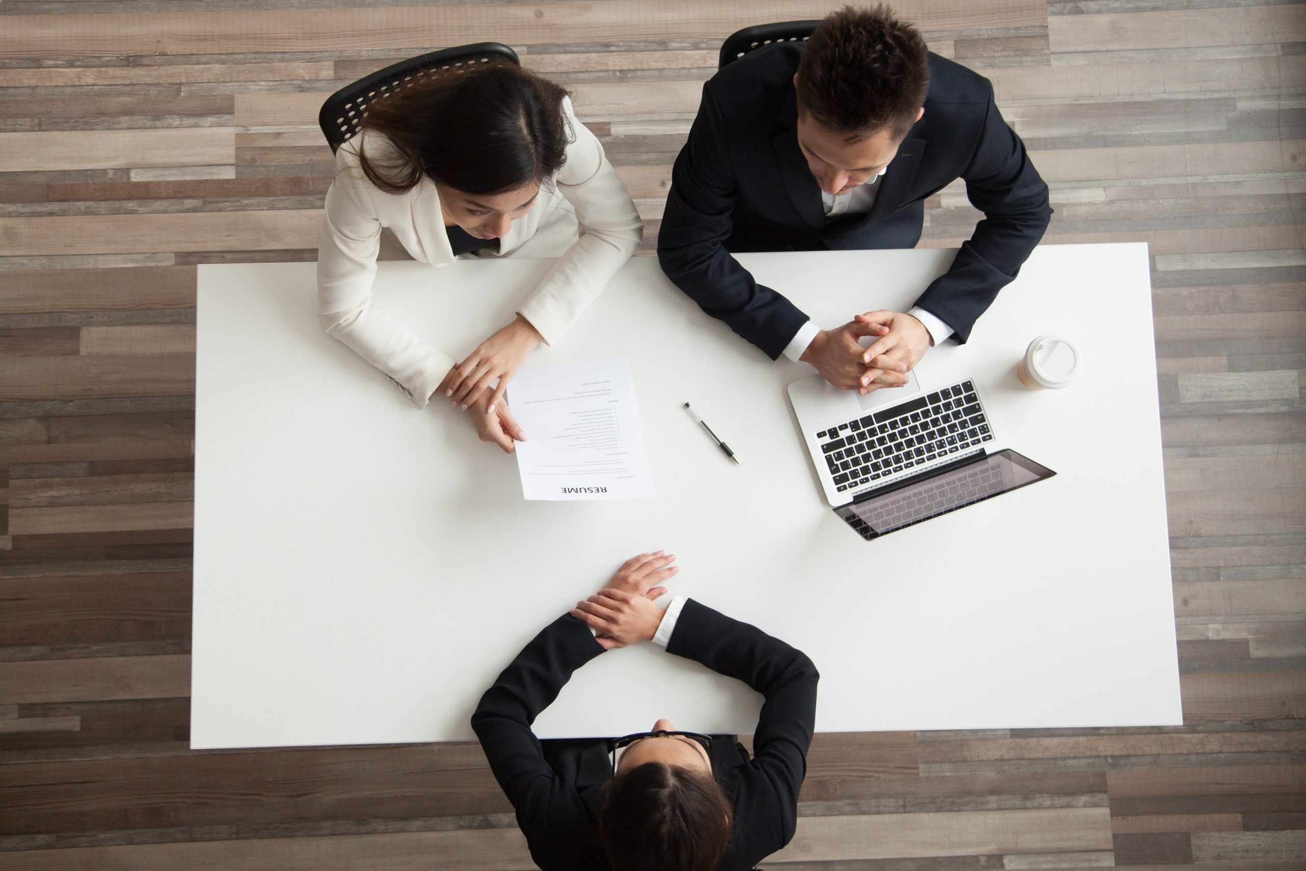 Hr managers interviewing female job applicant, recruiters listen to candidate answering questions at hiring negotiations, recruiting and staffing, making first impression concept, top view from above