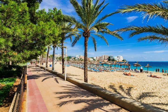 Spain Majorca, view to the coastline and promenade alley of Magaluf sand beach, mediterranean sea coast.