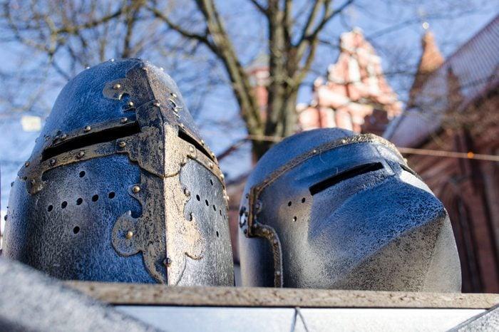 metal medieval ancient knights warrior helmets imitations sold in outdoor street market fair.