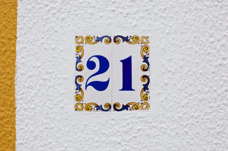 ceramics house number on the wall twenty one