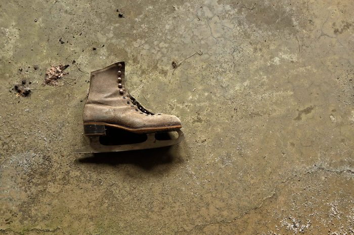 Old ice skate on the floor. Off center.