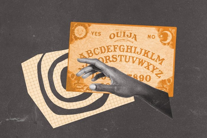 Ouija board collaged with swirl motif and outreached hand