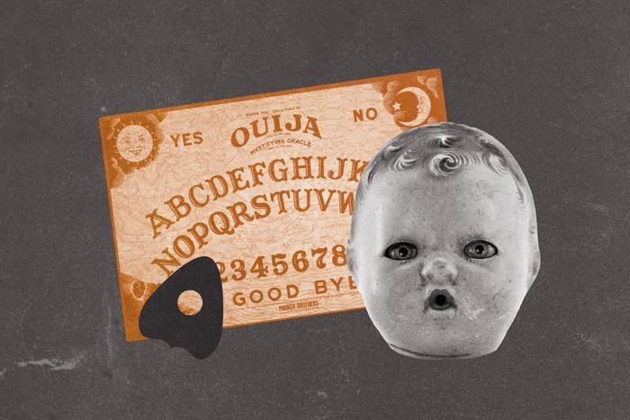 Ouija board and planchette with doll head