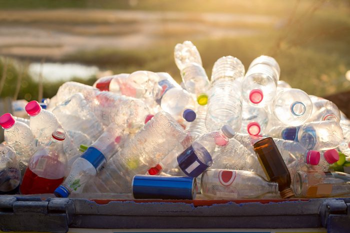 Recyclable garbage of glass and plastic bottles in rubbish bin