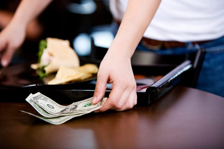 Coffee Shop: Server Picking Up a Cash Tip