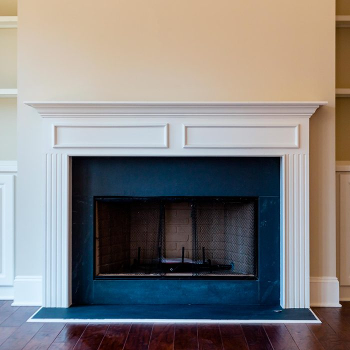 A gas burning fireplace in a new home