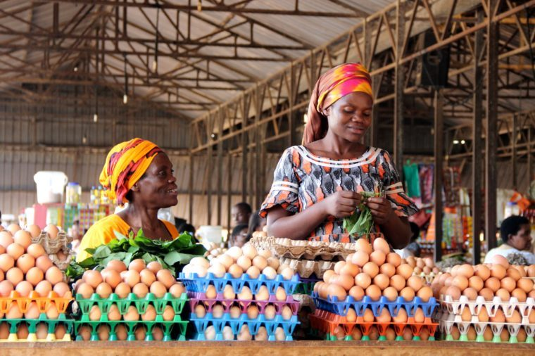 Rwandan women selling eggs to people visiting the Kimironko market in Rwanda's capital city.