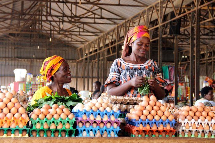 Rwandan women selling eggs to people visiting the Kimironko market in Rwanda's capital city.