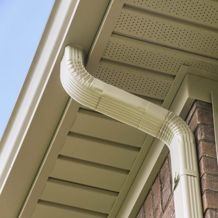 Gutter and downspout near the roof of a house