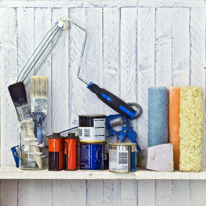 Do it Yourself (DIY) and decorating tools on workshop shelf -- good copy space on white-painted wall