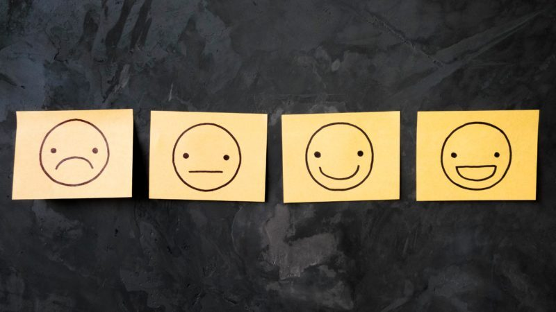 stickie sticky post it notes on chalkboard black background emotions faces scale