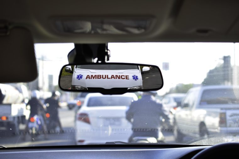 ambulance in rear view mirror