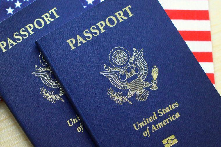 US passports on american flag