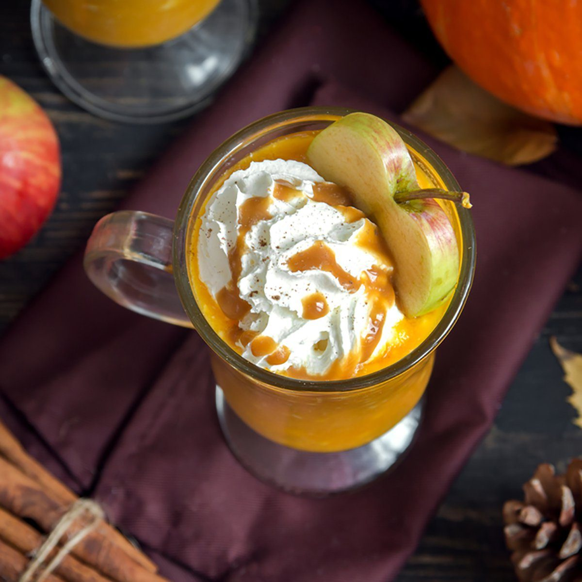 Apple Cider Floats with caramel sauce and pumpkin pie spices.
