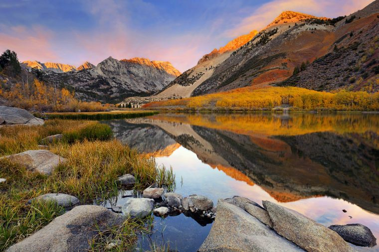 Small Sierra Nevada lake reflection spectacular fall color at dawn.