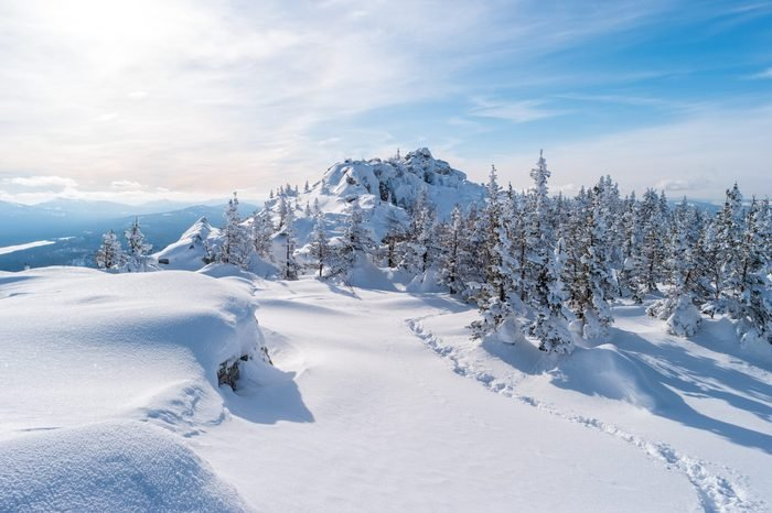 Beautiful landscape with snowbound Zyuratkul ridge. Winter in The Ural Mountains.