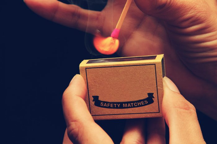 Light my Fire - someone holding a matchbox while striking a match