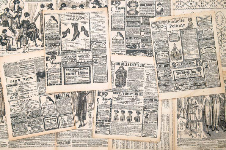 FRANCE, PARIS - CIRCA 1919: newspaper pages with antique advertisement. Woman's fashion magazine Le Petit Echo de la Mode