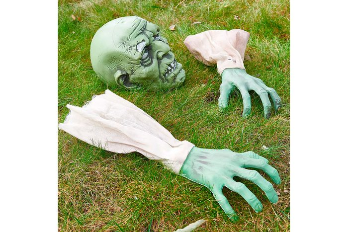 zombie head and arms halloween lawn decor