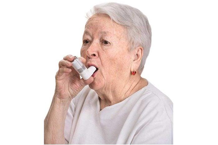 elderly woman using inhaler wall sticker