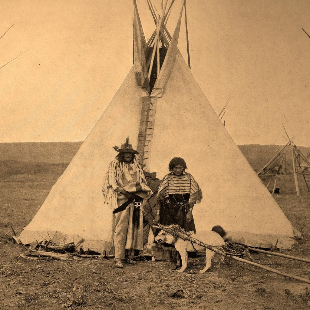 Indian Chief with his wife in front of their tent, historical photo, United states of America 2010s