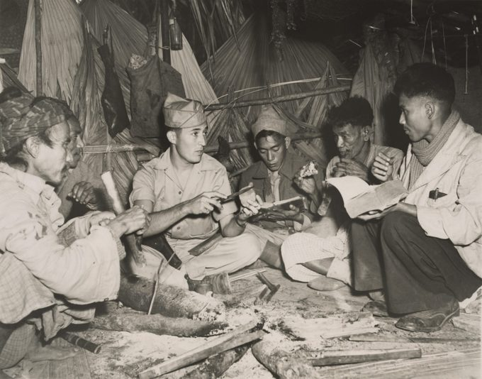 American Army Sgt. James Fletcher, with some Kachin scouts in Burma during World War 2. The Kachin natives provided information vital to the builders of the Ledo Road 1940s