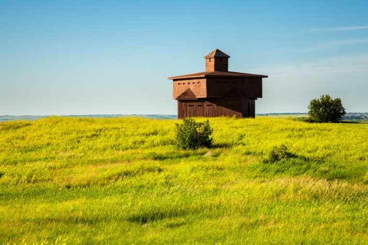 A reconstructed infantry blockhouse on the open priarie in Fort Abraham Lincoln State Park. It is a North Dakota state park located 7 miles south of Mandan, North Dakota