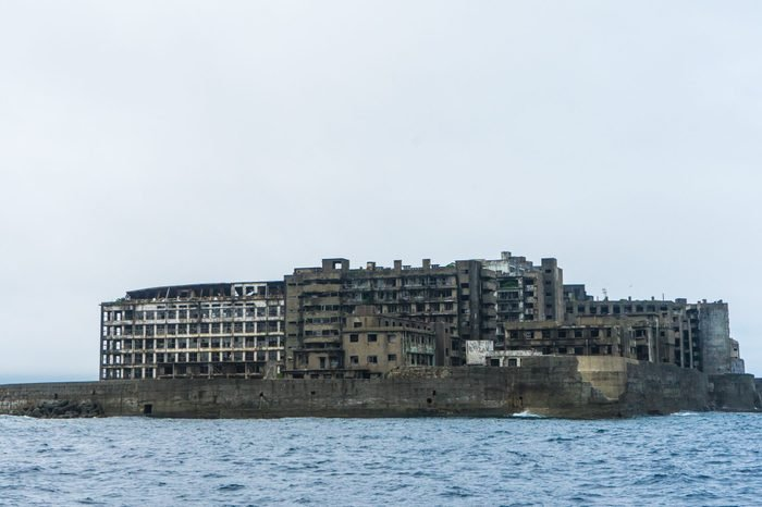 Hashima Island in Nagasaki, Japan. Also called Battleship Island. A symbol of the rapid industrialization of Japan. It is a UNESCO World Heritage site.