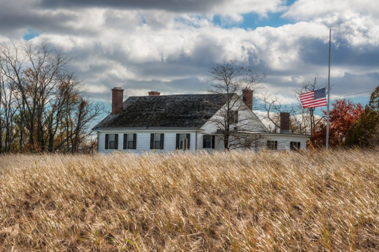 The US flag flies over the historic Seabrook Wilson house in Bayshore Waterfront Park in Monmouth County New Jersey.
