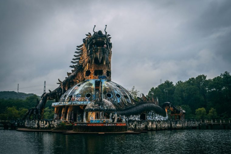 Dark tourism attraction Ho Thuy Tien abandoned waterpark, close to Hue city, Central Vietnam, Southeast Asia. Famous Dragon statue in the middle of the waterpark.