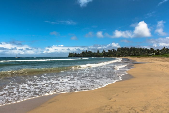 Sand beach along Hanalei Bay coast, Kauai, Hawaii