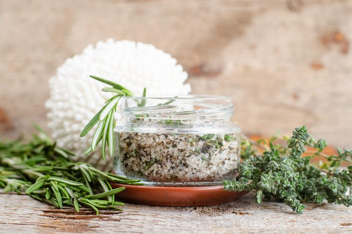 Homemade herbal scrub (foot soak or bath salt) with rosemary, thyme, sea salt and olive oil. Natural skin and hair care. DIY beauty treatments and spa recipe. Copy space
