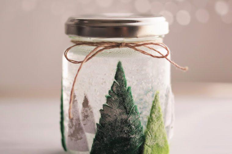 Christmas snow globe handmade of used glass bottle