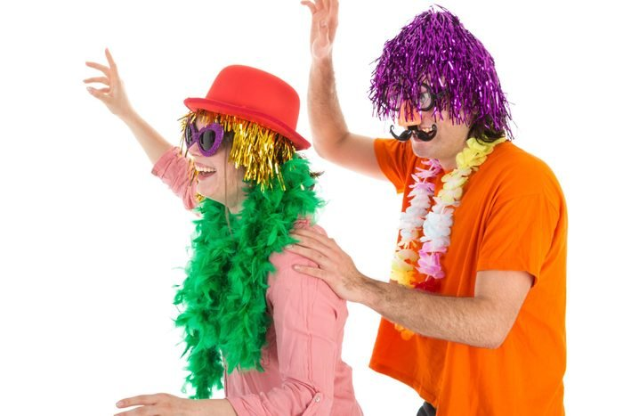 Man and Woman dressed in funny carnival costumes dancing a polonaise