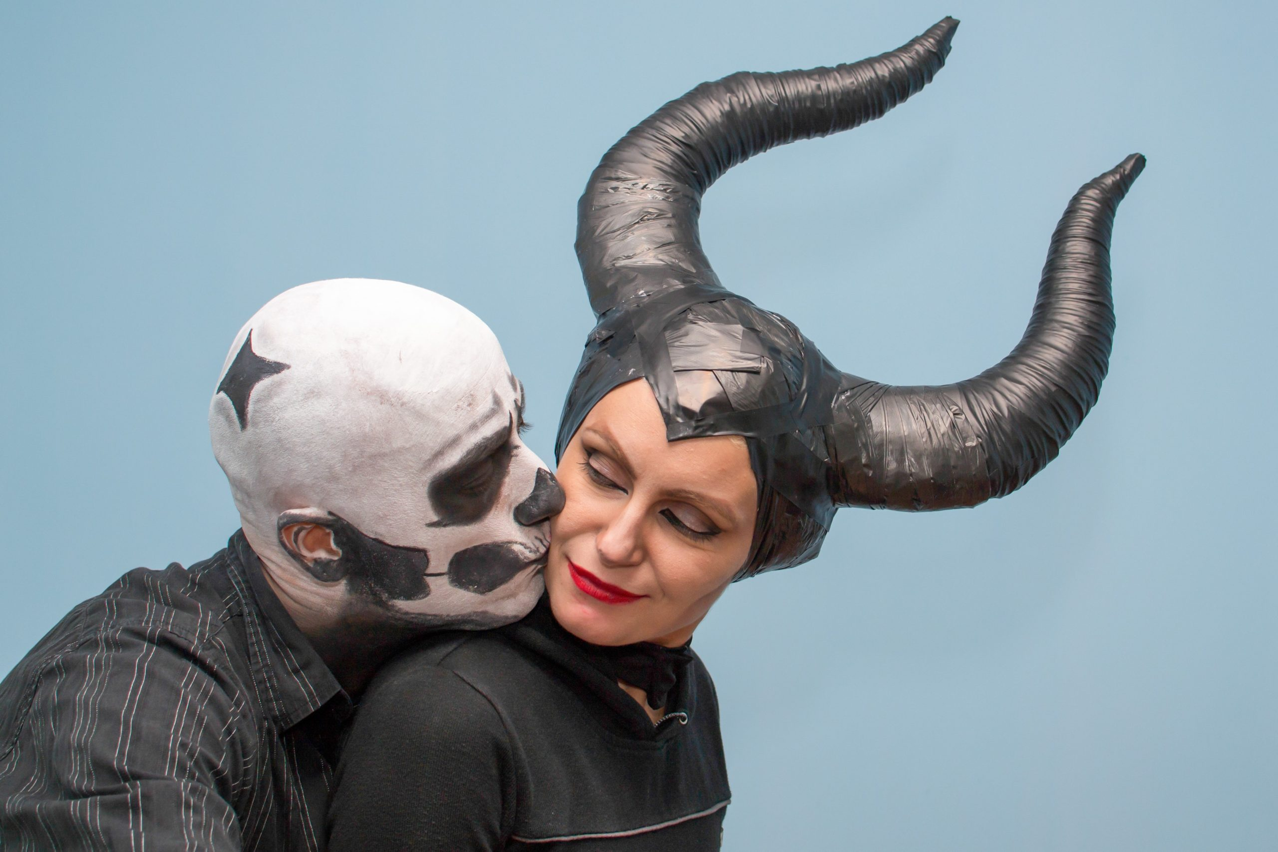 Couple in Halloween costumes and makeup
