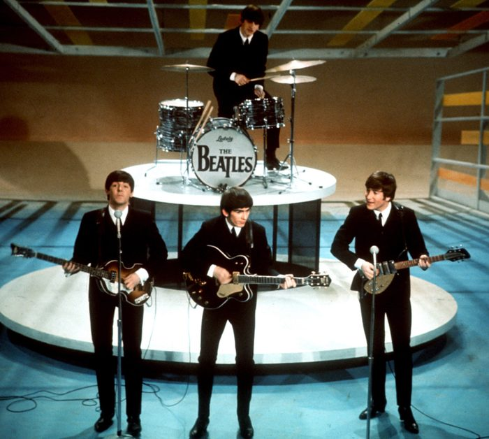 """Mandatory Credit: Photo by Anonymous/AP/Shutterstock (6651471a) Paul McCartney, George Harrison and John Lennon. Ringo Starr The Beatles, from left, Paul McCartney, George Harrison, Ringo Starr on drums, and John Lennon perform on the CBS """"Ed Sullivan Show"""" in New York. The Beatles made their first appearance on """"The Ed Sullivan Show,"""" America's must-see weekly variety show, on . And officially kicked off Beatlemania TV-Beatles-Sullivan, NEW YORK, USA"""
