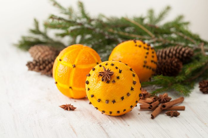 Oranges for decoration for the new year. Decorating oranges with cloves for the holiday.