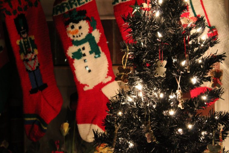 christmas stockings and gifts around the tree