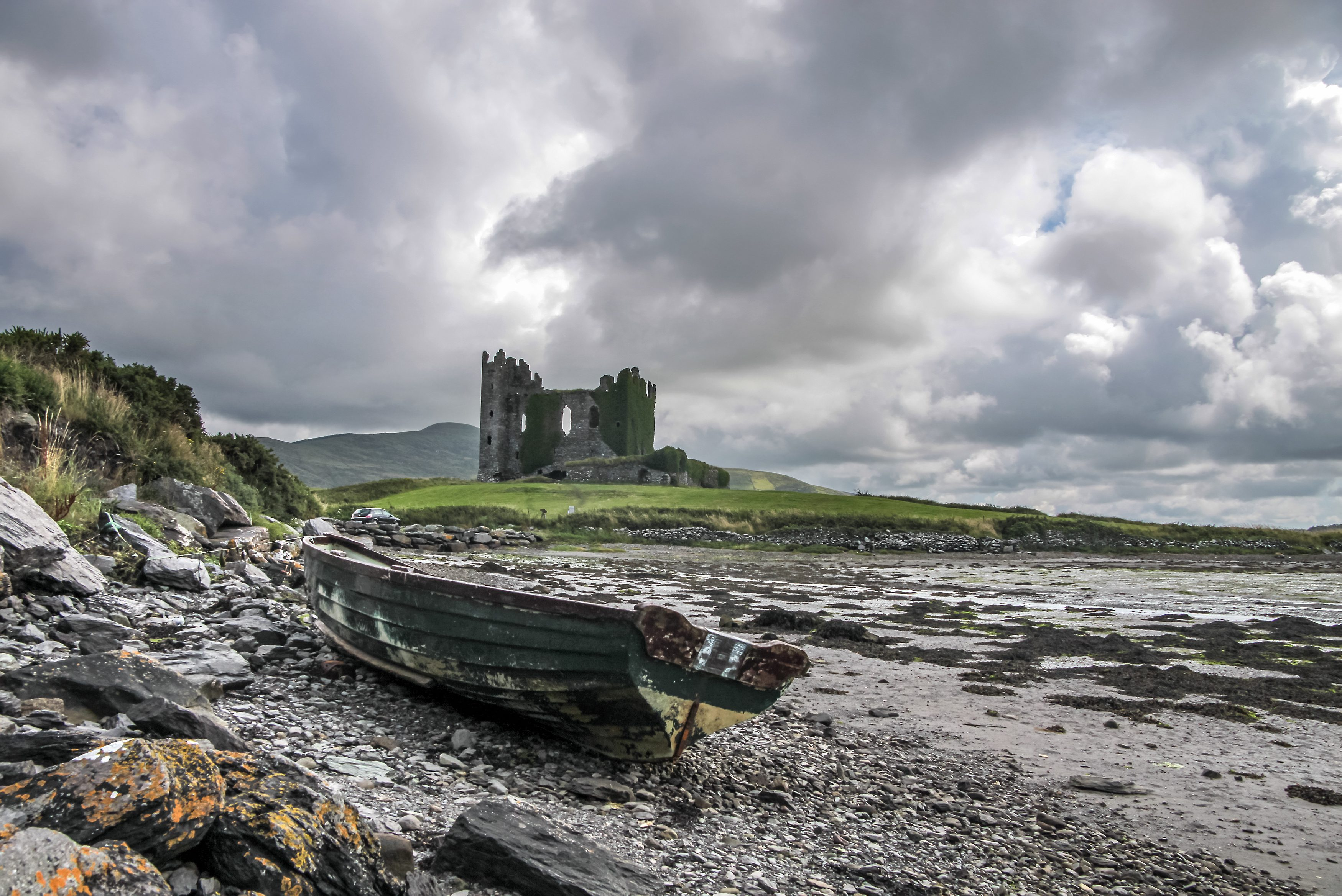 Ballycarbery Castle with old boat