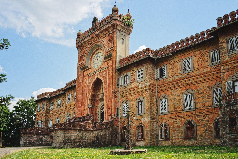 Main entrance with clock of Sammezzano castle in Tuscany