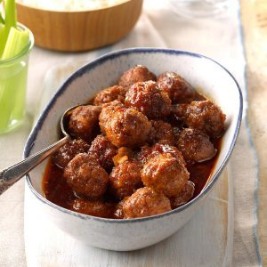 A bowl full of meatballs in honey buffalo sauce