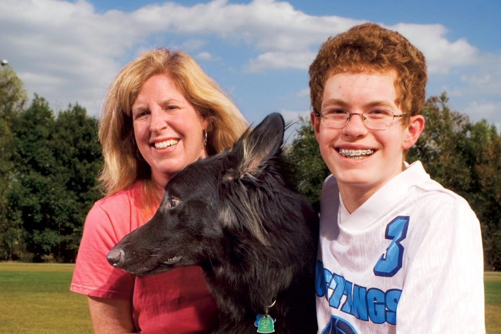 Michael Auberry with Mom and Search Dog