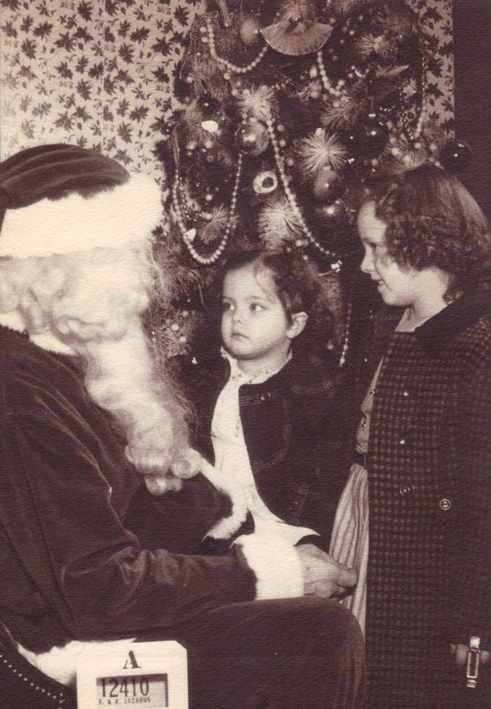 This is one of those pictures that brings back wonderful childhood memories. It was taken at Lazarus Department store in downtown Columbus Ohio. Lazarus is long gone; but not forgotten. Going to Lazarus was always a great adventure when we were children. At least one whole floor was dedicated to children; all year round. Their street level windows were always filled with beautiful displays at Christmas time.I am the younger of the two sisters in this picture. My sister Linda is with me. This is also the only picture I have that includes Santa. It was taken in 1955.